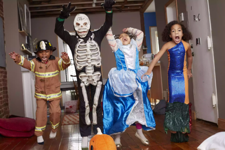The Spruce_children-in-halloween-costumes-jumping-for-joy-557474483